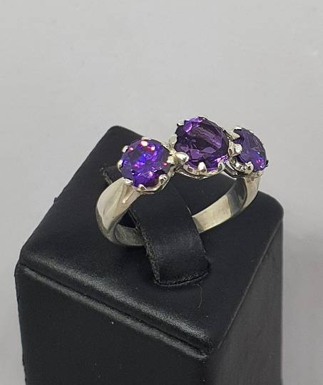 Sterling silver ring with sparkling purple gemstones