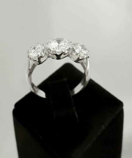 Claw set, sterling silver brilliant cubic zirconia ring