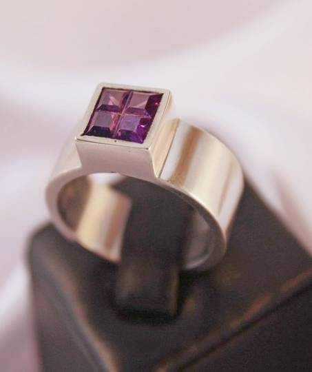 Sterling silver ring with deep purple stone
