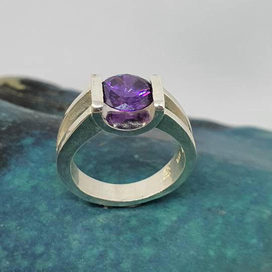 Open sides, sterling silver ring with purple stone