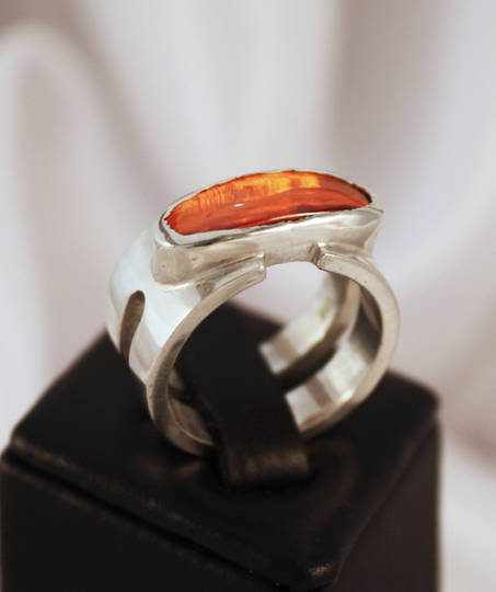 Wide band silver ring with orange stone