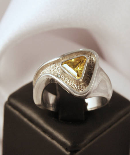 Sterling silver ring with golden yellow stone