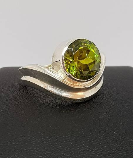 Round synthetic peridot, sterling silver ring