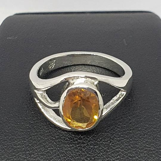 Sterling silver designer ring with yellow gemstone