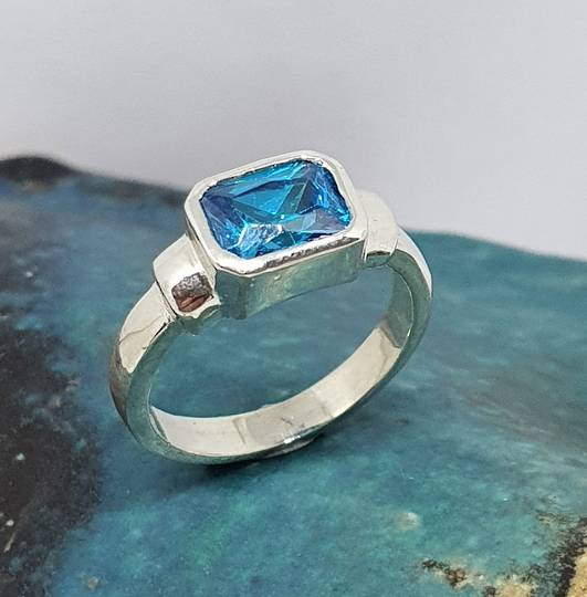 Sterling silver ring with blue topaz rectangle stone