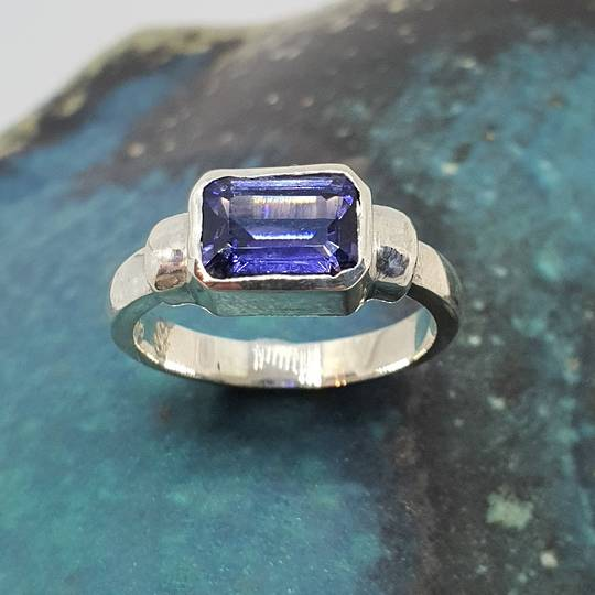 Sterling silver ring with sapphire blue rectangle stone