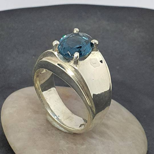 Wide silver band ring with blue topaz simulated gemstone