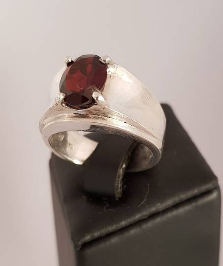 Wide silver band ring with red garnet gemstone