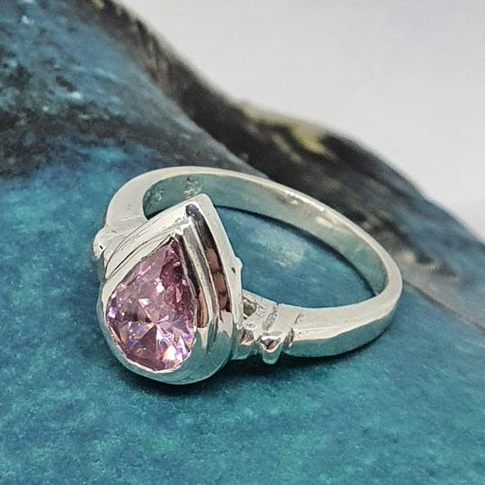 Silver ring with pink sparkling stone