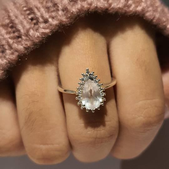 Teardrop rose quartz ring with cz setting