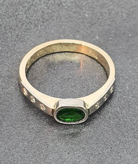 Gold and palladium ring with diamonds and imitation emerald