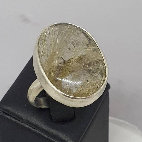 Sterling silver ring with large oval rutilated quartz