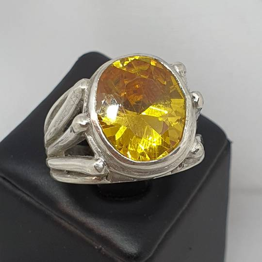 Chunky sterling silver designer ring with large yellow gemstone