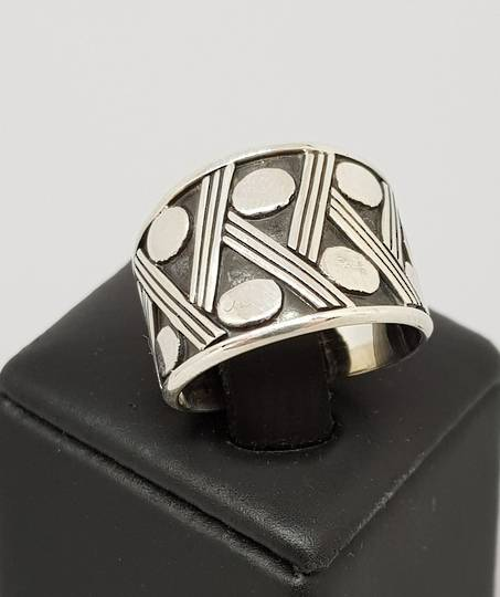 Cool silver band ring with interesting designs
