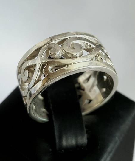 Sterling silver wide band with carved koru designs