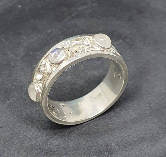 Sterling silver moonstone ring with koru swirls