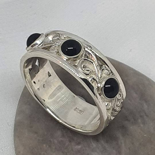 Sterling silver black onyx ring with koru swirls