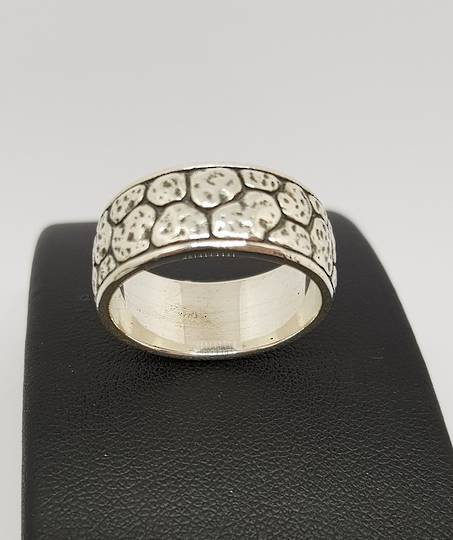 Sterling silver wide band ring with crazy paving pattern