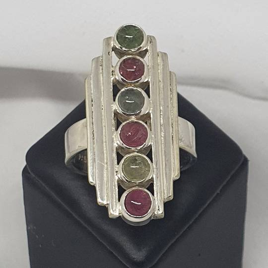Long rectangle ring with green and red gemstones