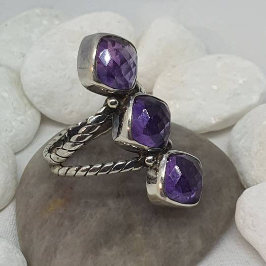 Sterling silver ring with three facet cut amethyst gems