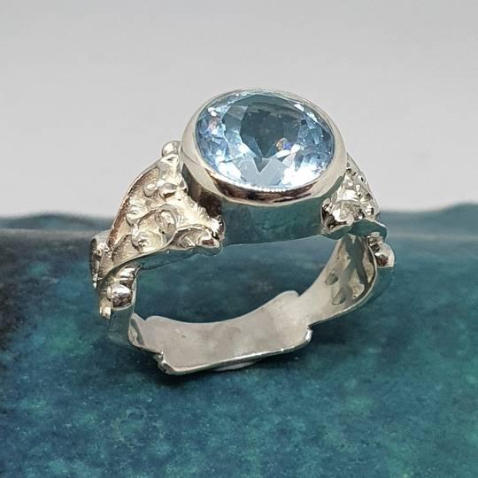 Sterling silver blue topaz gemstone ring
