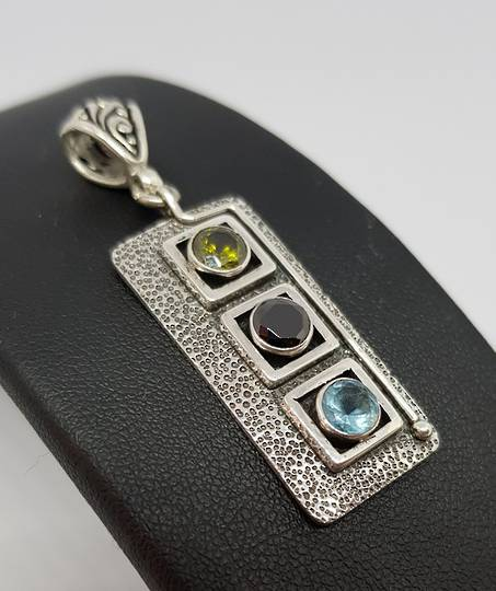 Sterling silver pendant with gemstones