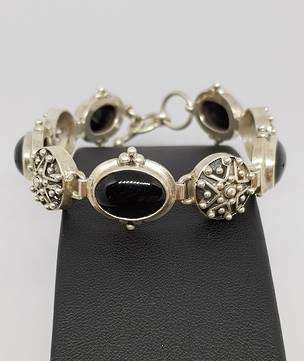 Sterling silver onyx bracelet with carved silver discs