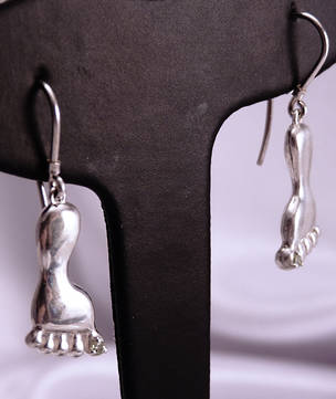 Unusual sterling silver earrings - a foot with a cubic zirconia.