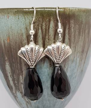 Silver earrings with facet cut onyx beads