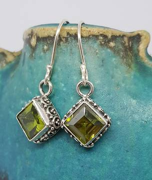 Silver peridot earrings with filigree detail