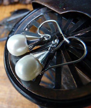 White pearl earrings set in sterling silver cup