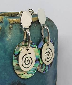 Silver paua shell earrings with silver koru disc