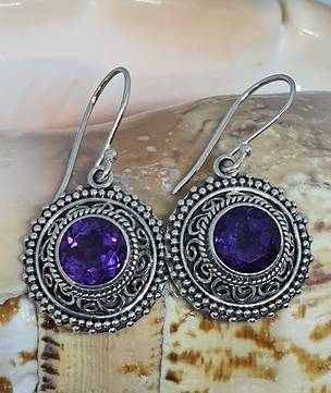 Silver earrings with purple stone