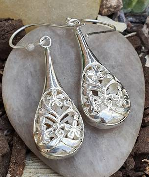 Sterling silver carved hook earrings