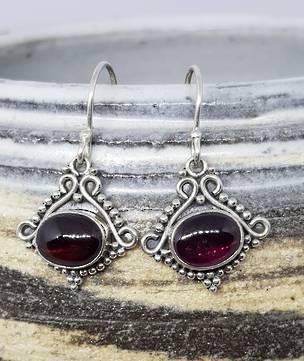 Sterling silver garnet earrings in decorative frame