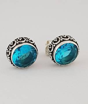 Alluring blue topaz stud earrings