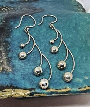 Long silver multi sphere earrings