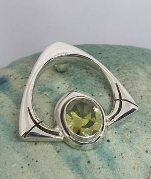 Silver peridot pendant, open triangle