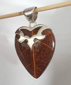 Heart shaped brown skeleton leaf pendant