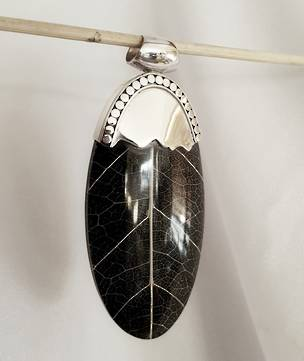 Black skeleton leaf pendant with silver detailing