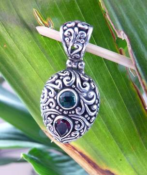 Heavy sterling silver carved pendant with gemstones