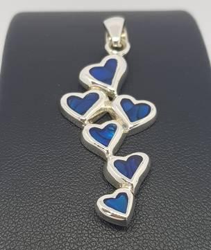 Dyed blue paua shell hearts pendant