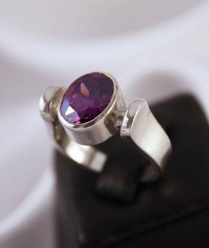 Horseshoe for luck   Silver ring with purple stone
