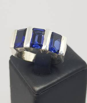 Sterling silver three stone synthetic sapphire ring