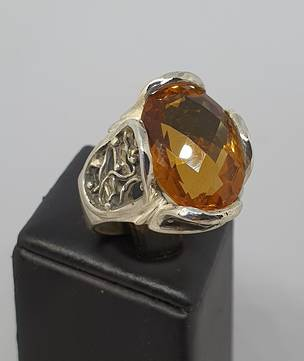 Chunky sterling silver ring with large orange gemstone