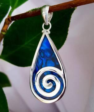 Dyed blue paua shell silver pendant