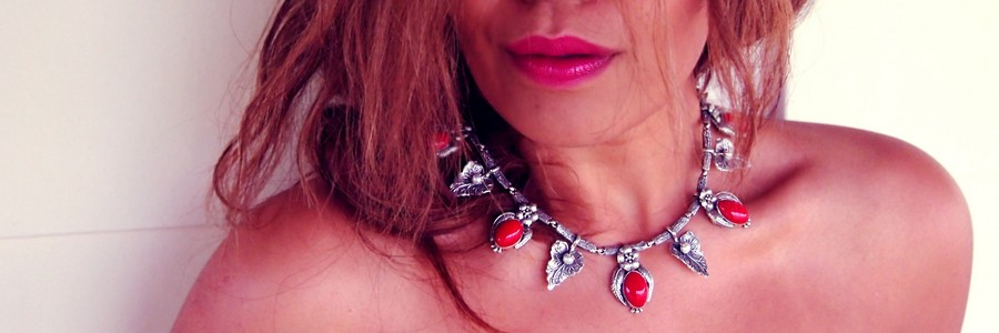 red gems and pearl necklace