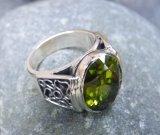 silver peridot ring close up 1