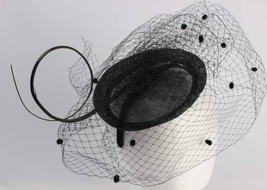 Hatinator with sinamay base,dotted net and twig black Style: HS/1357