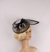 Hatinator in sinamay w blk and white feathers, a curved extended base, band, black Style: HS/3004/BLK